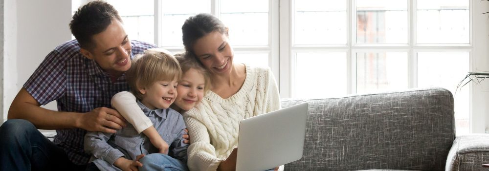 Happy family getting home improvement offers -Chicago - Midwest Windows Direct