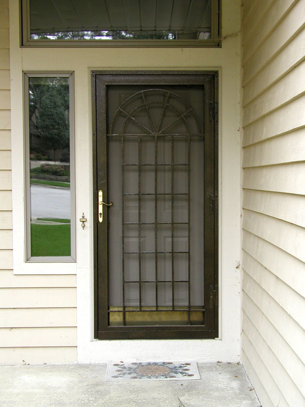 Security storm doors midwest windows for Storm door window